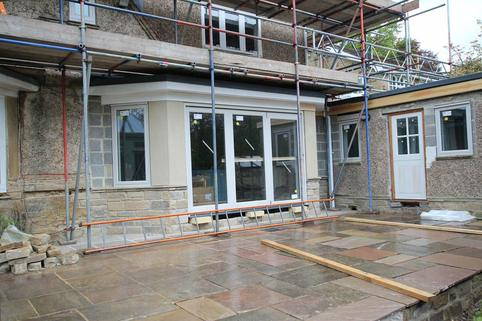 Windows, bi-fold doors and patio installed